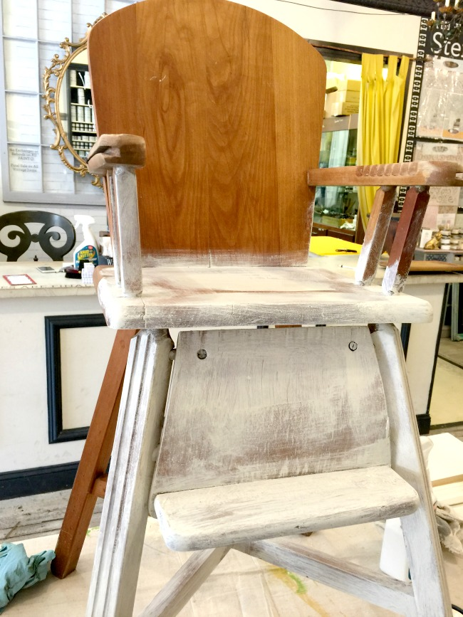 Partially painted wooden highchair