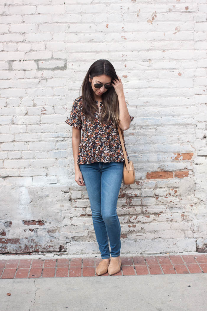 floral top and skinny jeans