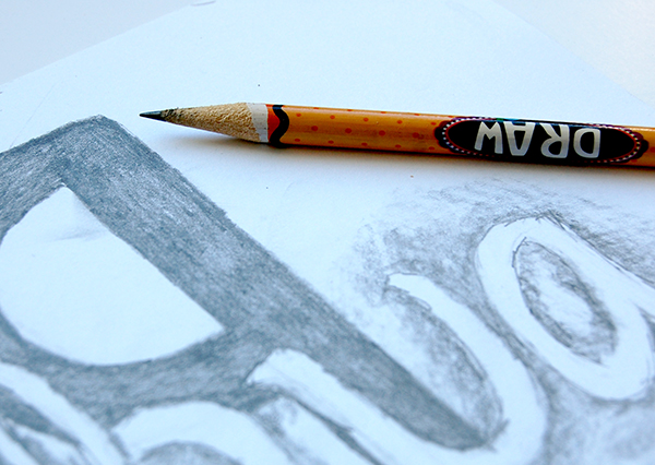 joshua 1:9 handlettering logo concept on drawing paper using a No.2 pencil upclose image