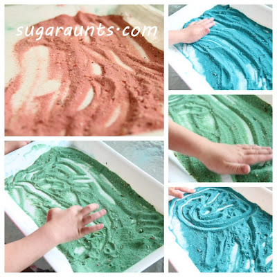 colored sand on tray for child to form letters