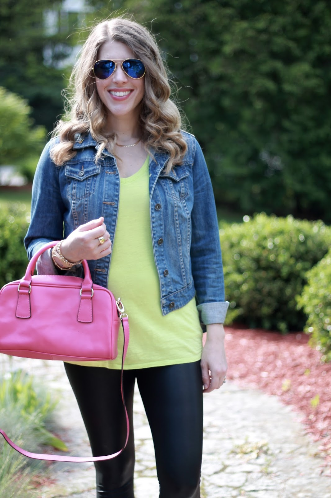 neon yellow tee, denim jacket, maternity leather leggings, Nike flyknit tennis shoes, pink bag