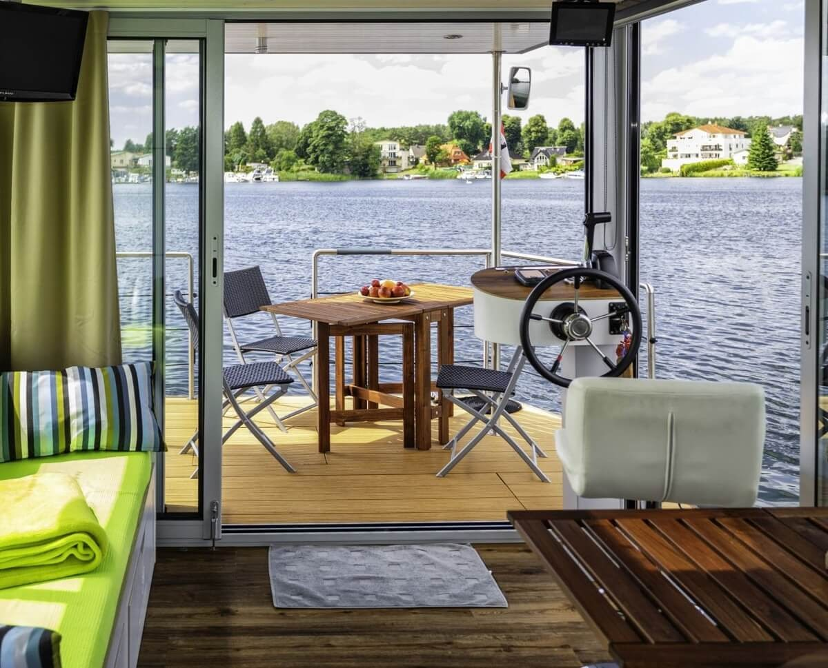 04-Dining-Deck-and-Piloting-Controls-Nautino-Tiny-Houseboat-Architecture-on-the-Water-www-designstack-co