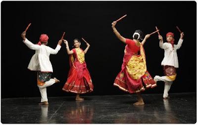 Dandiya Raas perfomed by men and women during Navratri