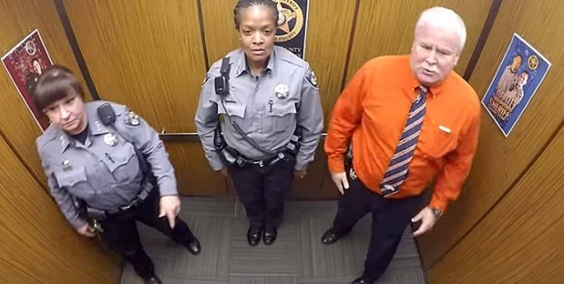 police officers in an elevator