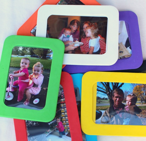 A creative and personalized gift idea for a one year old or a toddler- Family photos framed in colored foam. My toddler LOVES this!