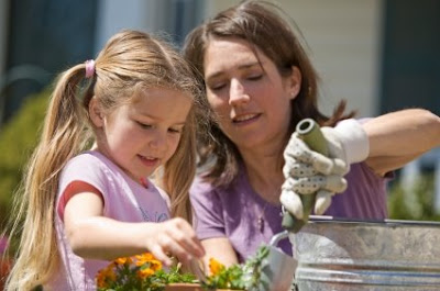 NAMC montessori parent a family decision choose montessori mother daughter gardening