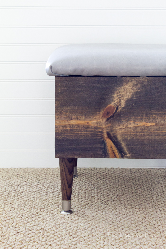 How to make an easy DIY wooden storage ottoman with a leather upholstered lid. #MonthlyDIYChallenge