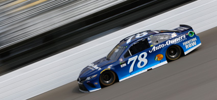 Martin Truex Jr., driver of the #78 Auto-Owners Insurance Toyota, practices for the Monster Energy NASCAR Cup Series FireKeepers Casino 400