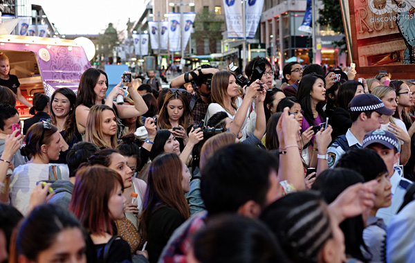 Photographers, Crowd and Police watch Miranda Kerr, KORA Marquee Martin Place Sydney VFNO