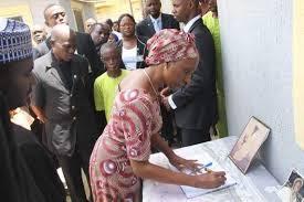 Mrs. Osinbajo signing