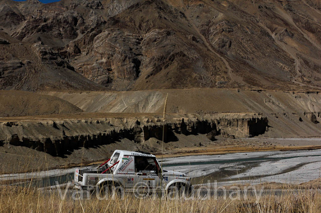Maruti Suzuki Raid-de-Himalaya is India's toughest and most demanding motorsport rally which happens in Northern states of India - mainly Himachal Pradesh and J&K. Raid De Himalaya is open for both car and bike enthusiasts .... and for professional as well as amateur motorsport lovers.  Let's have a quick PHOTO JOURNEY by Varun Chaudhary (from Raid de Himalaya 2011)This journey is only covering some of the action shots of cars and another photo journey on bikes will follow soon... Above photograph shows a car flying across the snow covered hills and monasteries on the way while going towards J&K....The participants drive through some of the world's highest motorable roads and passes in the Himalayas like Jalori Pass, Rohtang Pass, Kunzum La, Baralacha La, Tanglang La & Khardung La, through really difficult terrains in Lahual and Spiti valleys in the Ladakh region.During Raid de Himalayas, all participants need to take care of their food on their own. Folks from various parts of country and world come to Himachal for Raid de Himalayas. Many folks have real craze about riding in Himalayas and face the real challenge in the world of motorsports.Most of the drive is through  snow covered hills of Himalayas, beautiful water streams and at times, temperature below -15 degree Celsius. On an average, a participant covers a distance of 300 kms every day in this approximately 1800 km and week-long motoring event.During the Raid, environment changes suddenly... These cars move so fast and suddenly snow covered hills touch to a land with rocky & dry hills... Most of the vehicles used during the rally for marked fit before start, otherwise folks are not allowed to continue to take care of security of participantsMaruti Suzuki and Himalayan Motorsport Association organize the Maruti Suzuki Raid-de-Himalaya every year  which actually need hard work and preparations. Spirit of motoring enthusiasts and Maruti Suzuki's commitment to promote motorsport in India has kept it going - year after year.It's always a wonderful experience to capture these folks at special moments with special effects.... Panning could be one of the very good ways of showing real action during Raid de Himalaya !!!If I clearly read, it's Sarachu written over the meter-board on road-side...Every year, more and more people participate in the Maruti Suzuki Raid-de-Himalaya and some of them from abroad as well. Maruti Suzuki Raid-de-Himalaya is the only Indian motorsport event listed on the off-road rallies calendar of FIM (Federation Internationale Motorcyclisme), Geneva, Switzerland. Only 12 international motoring events world-wide are listed in this calendar.The Maruti Suzuki Raid-de-Himalaya is held around October, just before the onset of winters in the Himalayan region and passes through lot of snow covered hills !!!The Maruti Suzuki Raid-de-Himalaya runs in three separate versions: Xtreme, Adventure Trial and Bike Xtreme !!!Xtreme is the toughest of Raid de Himalaya and it's open only to those 4 wheeler drivers who have prior rallying experience and have competed in one of the earlier editions of the Maruti Suzuki Raid-de-Himalaya or Maruti Suzuki Rally Desert StormAdventure Trial is open to those motor-sports enthusiasts who would like to take on the Himalayas but without the tough competition, difficulty and stress involved in the Xtreme. This section is open only to stock cars and only certain safety related modifications would be allowed in the competing cars. This is where first timers would fit in...   Car Category & SUV Category    Bikes Xtreme is open to bikes of all types and makes but there are certain regulations that they have to adhere to. The bikers are probably the bravest of the Raiders, as they have to face the hostile weather, terrain without the comforts of a cabin surrounding them.Some of the online media websites regularly track the progress of this one week long rally - Raid de Himalaya... One of the example can be seen at http://hillpost.in/category/sports/raid-de-himalayaAll these colorful cars in various sizes, shapes and models don't run but literally fly in air. Each car rider need to come with a navigator who can guide the rider about appropriate details about location, distance, timing and other security measures about controls etc.Also each team to make sure that helping car is coming along which has all necessary equipments for repairing the cars/bikes if needed... Many times these enthusiasts know much about their cars/bikes, but it's preferred to have specialists with them to be on safer side.It's of course an expensive affair and many folks get appropriate sponsorships to join such rallies. From vehicle to maintenance and all other miscellaneous expenses are too much... Even most of the vehicles are very well designed for such rallied.... They need to be really special to be a part of Raid de Himalaya....Raid de Himalaya 2011 was 13th event and 150+ participants came this time !!So here ends the cars rally during Raid de Himalaya 2011 and Bikers rally will follow soon... Varun Chaudhary who clicked all these photographs can reached at - Facebook Gmail