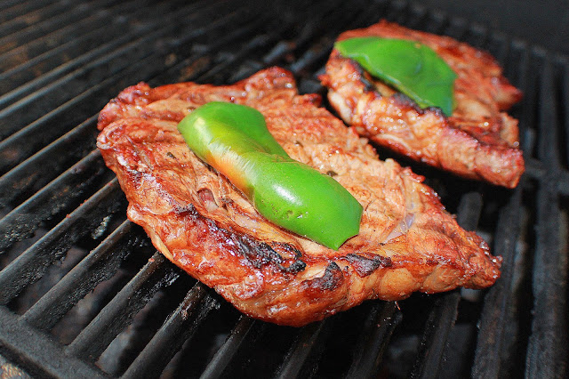steak on the grill with peppers Italian style seasonings