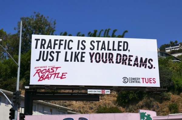 Traffic stalled Roast Battle billboard