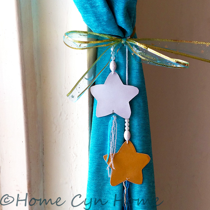 Make cute tassels for your curtains with beads, card stock and old bangles.