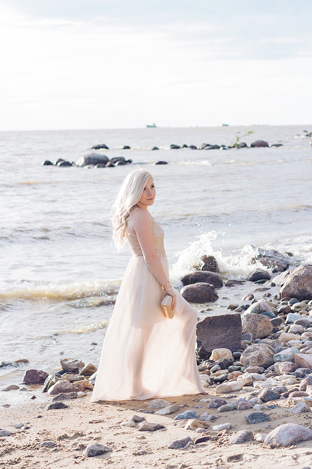 Fashion inspiration shoot at Victoria Beach.  Champaign chiffon dress with gold lace detailing and gold bow clutch.