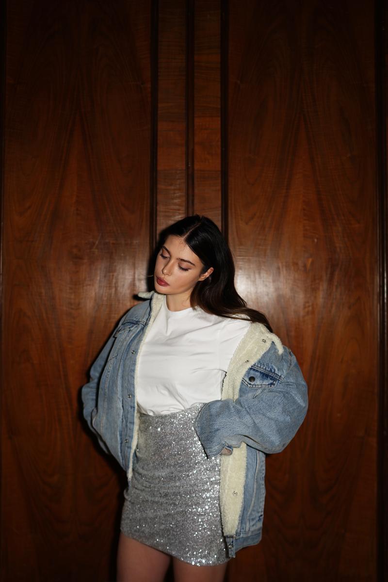 Reflective Yeezys & sequin skirt