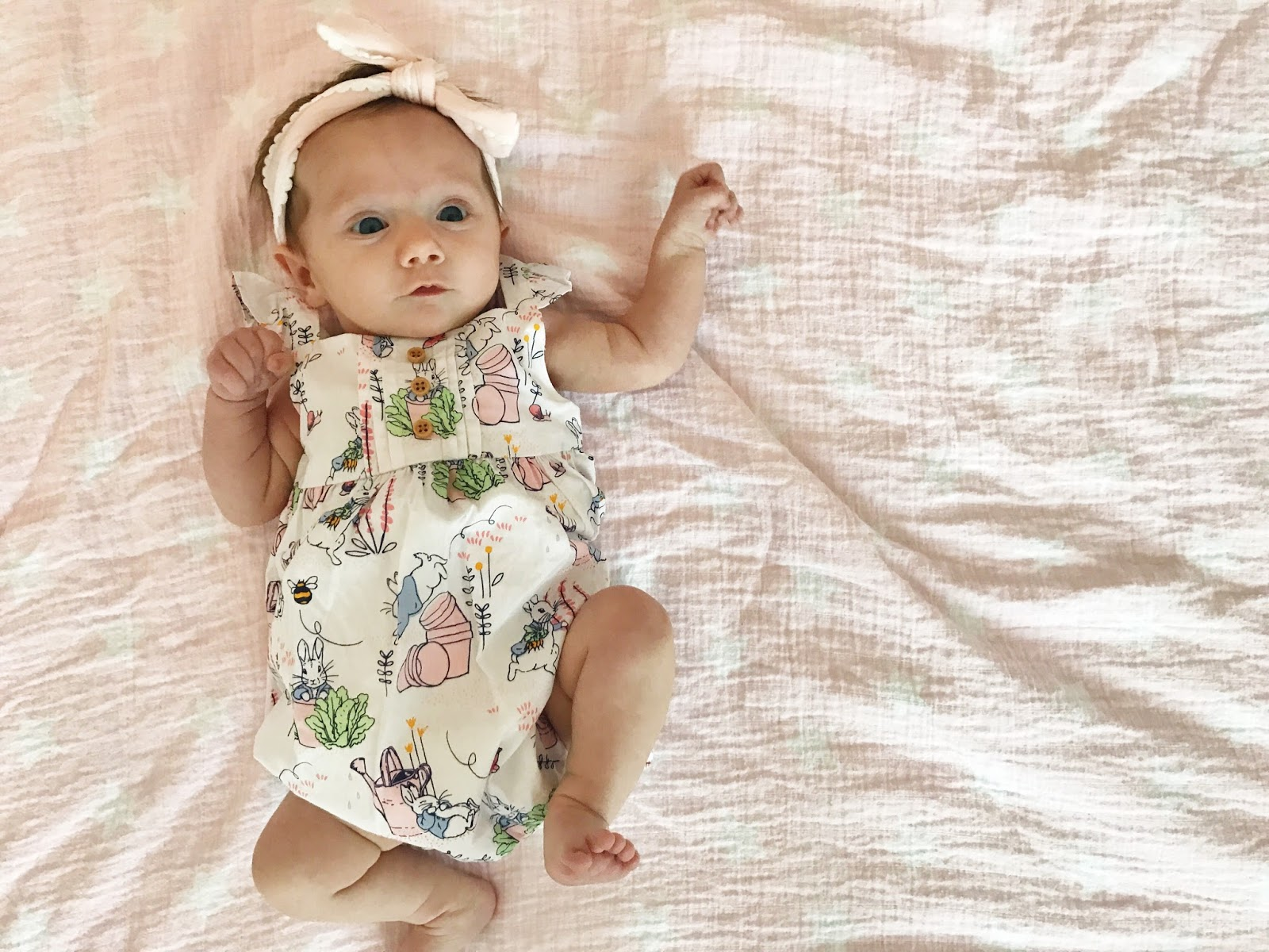 Festive ideas for babys first easter basket the chirping moms its hard to believe that this girl will be celebrating her easter in just a few weeks its time to get those baskets prepped and ready for the big day negle Images