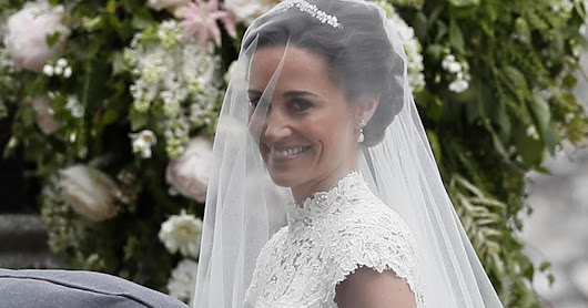 Stunning bride Pippa and groom James Matthews arrive at church for ceremony