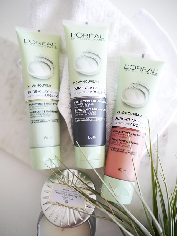 L'Oreal Pure-Clay Cleansers in green (Purifying & Mattifying), black (Energizing & Brightening), and red (Exfoliating & Refining)