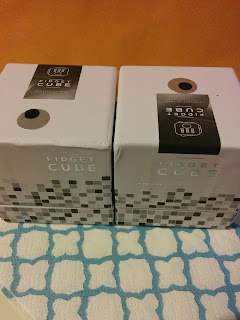 two boxed fidget cubes. Image from onequartermama.ca