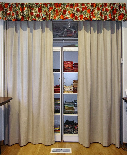frabric storage system: closet curtains close to protect fabrics from light damage and dust