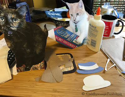 Flat Paisley and Webster waiting for their hats to be made.