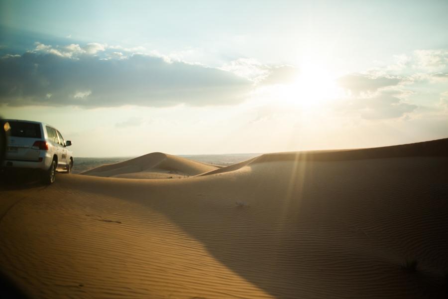 jeep sand dubai desert sun