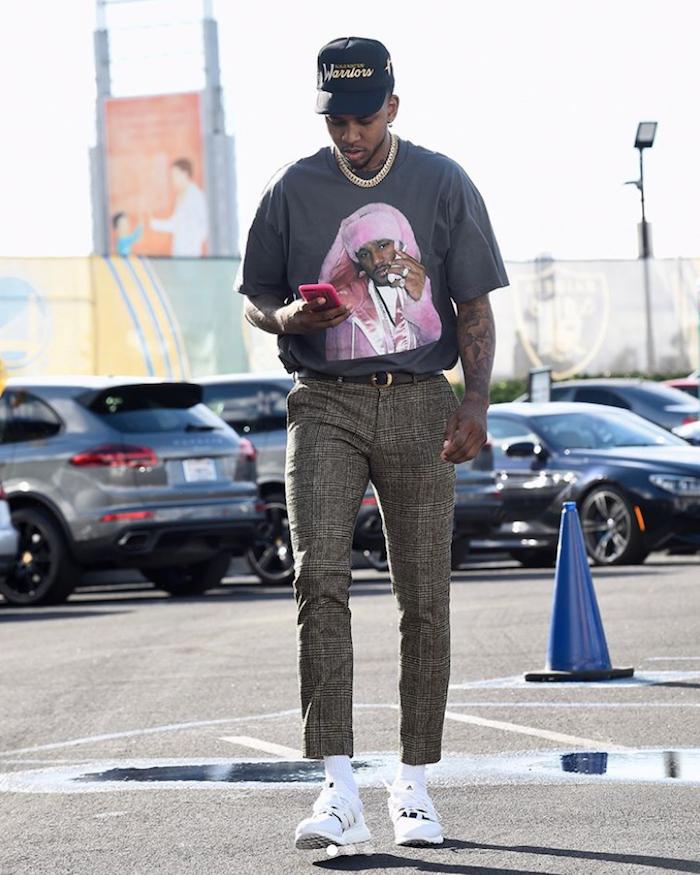 Nick Young wearing Kill the Hype LA hat and Killa cam pink shirt