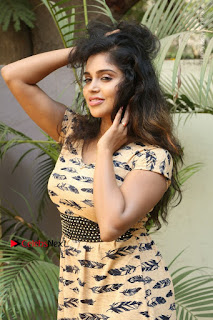 Telugu Actress Karunya Chowdary Stills in Short Dress at ATM Not Working Press Meet  0067.jpg