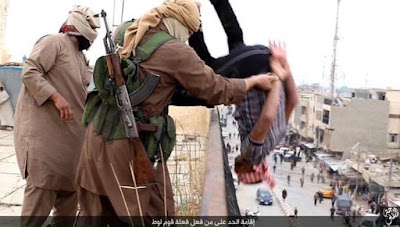 ISIS terrorists throw a gay man off a building top in Iraq in November 2015