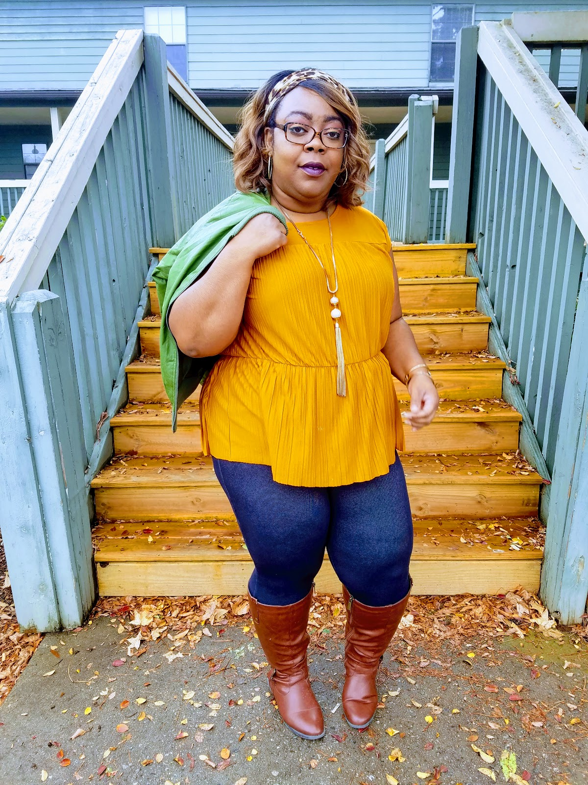 spicy mustard blouse, peplum hem, denim jeggings, cognac boots, green bomber jacket