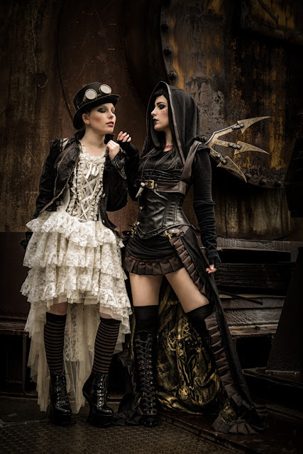 Women's steampunk clothing. White and ivory lace skirt and corset, black and brown steampunk clothing and boots.
