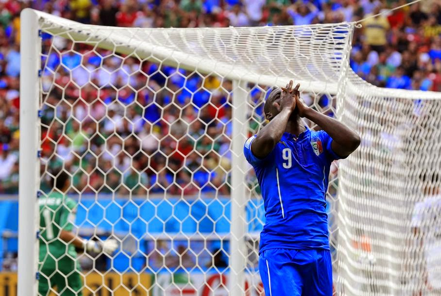 Italy's Mario Balotelli reacts after missing a chance during the group D World Cup soccer match between Italy and Costa Rica at the Arena Pernambuco in Recife, Brazil, Friday, June 20, 2014.