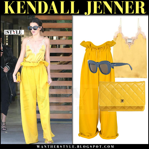 Kendall Jenner in yellow silk cami and yellow pants what she wore streetstyle march 2017