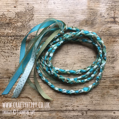 This image shows a handmade Handfasting Cord in shades of blue and turquoise.
