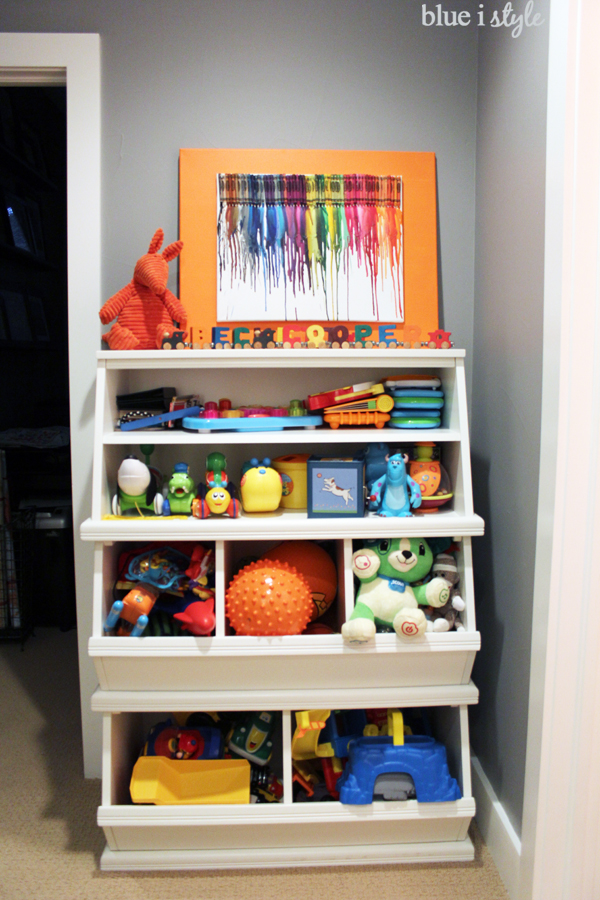 Toys stored in stacking toy bins