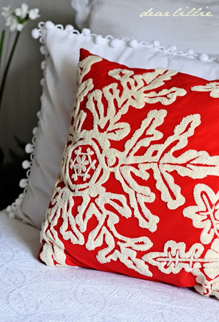 Beautiful red snowflake Christmas pillow from Dear Lillie | Friday Christmas Favorites at www.andersonandgrant.com