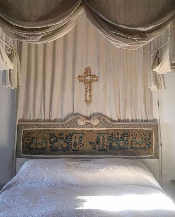 Above the bed. | bedroom details, cross, medieval decor | Allegory of Vanity