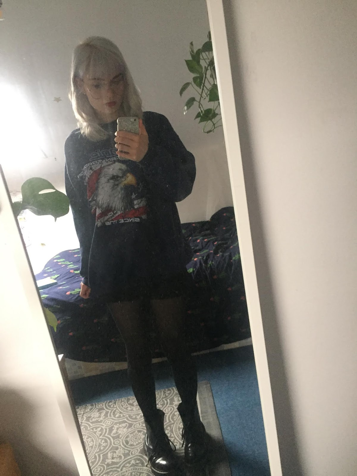 silver haired girl wearing vintage jumper, dms and red lipstick