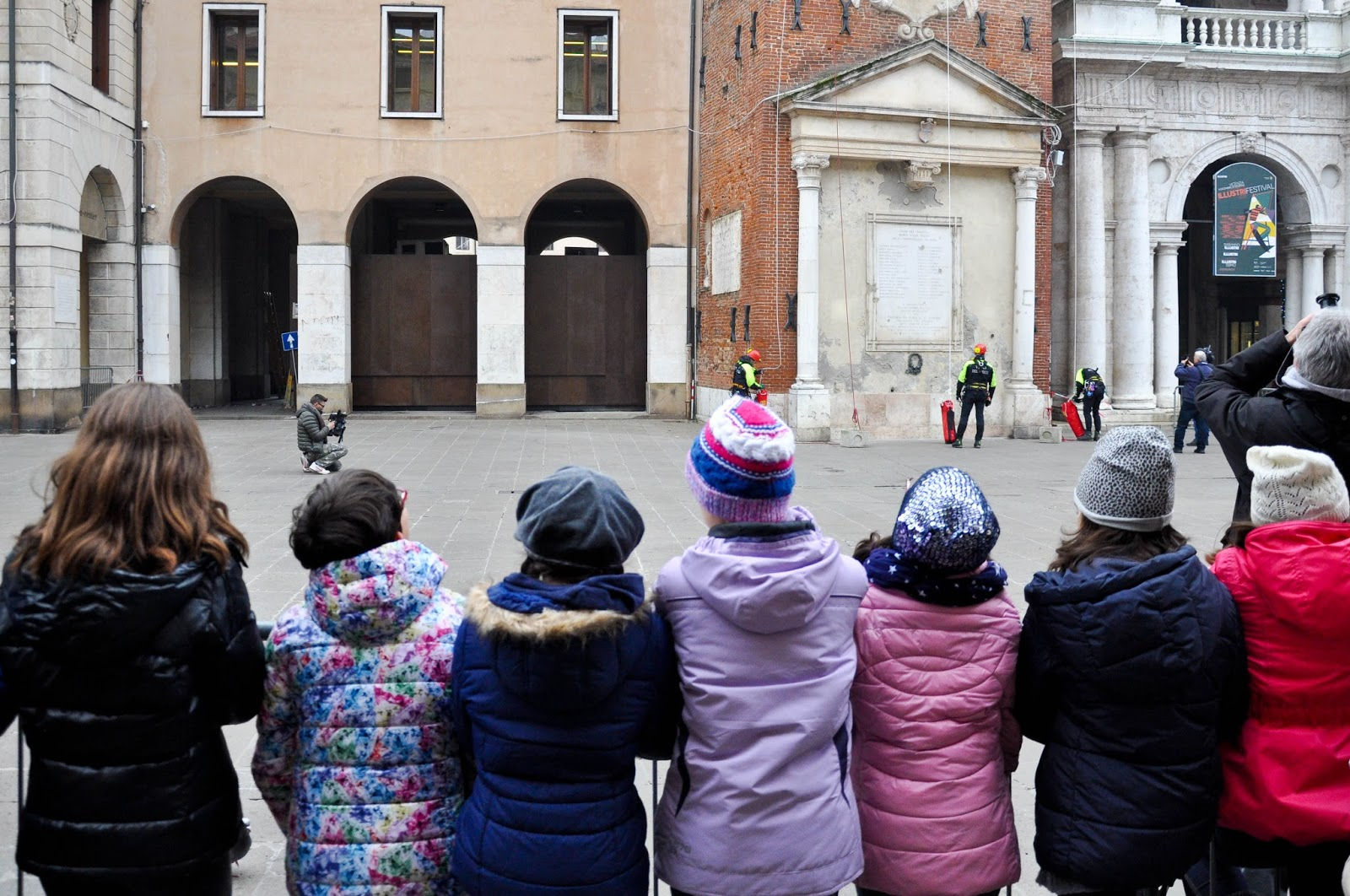 Children watching the firefighters' demonstration on Piazza dei Signori, Saint Barbara celebration, Vicenza, Veneto, Italy
