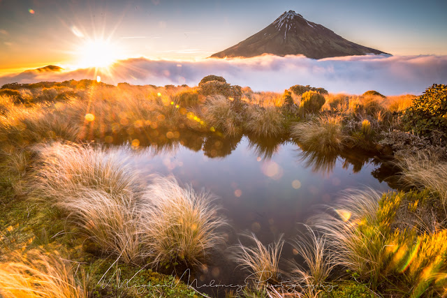mount taranaki sunflare tarn reflections