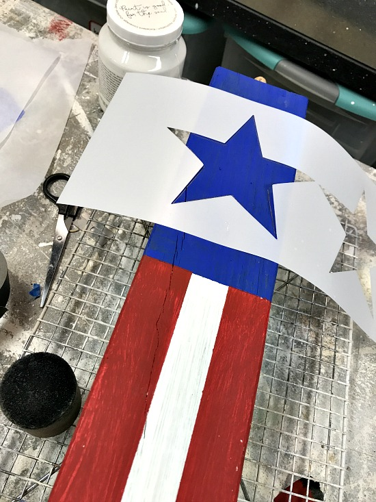 wooden firecracker for the fourth of July stenciling stars