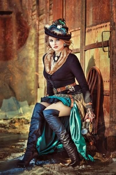 A russian woman's steampunk costume for cold wearther: fur trimmed sweater, skirt, boots, hat, goggles, lace gloves and gun.