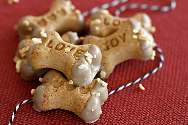 Homemade dipped dog treats with carob and sprinkled with nuts