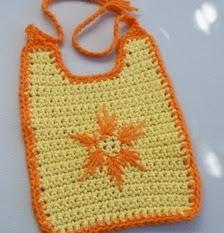 http://translate.googleusercontent.com/translate_c?depth=1&hl=es&rurl=translate.google.es&sl=en&tl=es&u=http://www.crochetspot.com/crochet-pattern-starburst-baby-bib/&usg=ALkJrhh7jSuQ8yciR_i-2u9HaH7zMhgGdw#more-24815