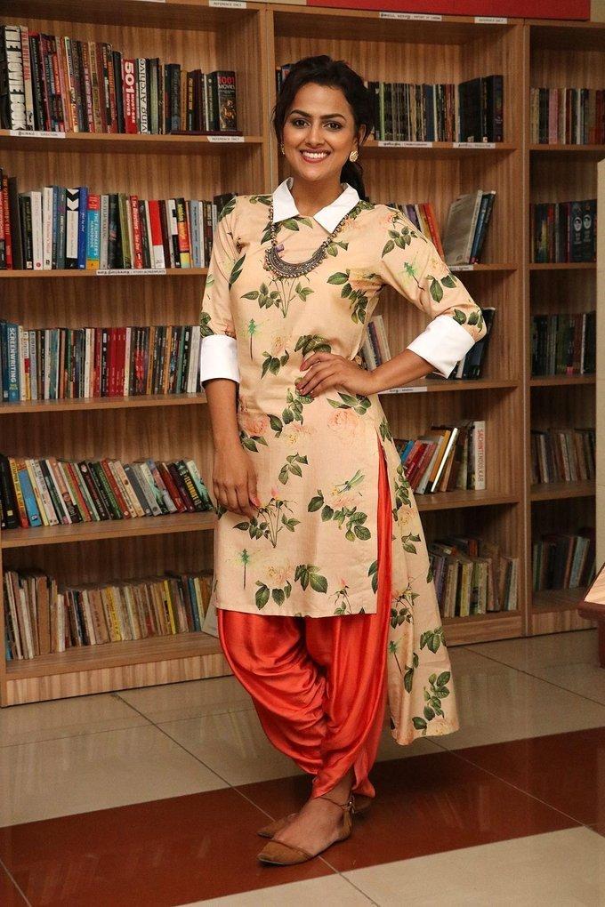 Beautiful Tamil Girl Shraddha Srinath Smiling Face Stills In Yellow Dress