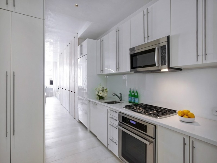 Kitchen in small apartment in New York by Rick Joy