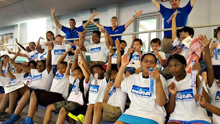 Campers on bleachers at SwimRVA Summer Camp in Richmond, VA