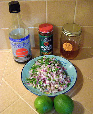 Honey, soy sauce, hoisin sauce, limes, chopped onion, garlic, ginger, and jalapeno