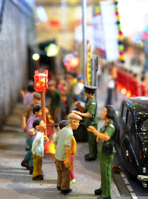 Figures on a model Hong Kong street.